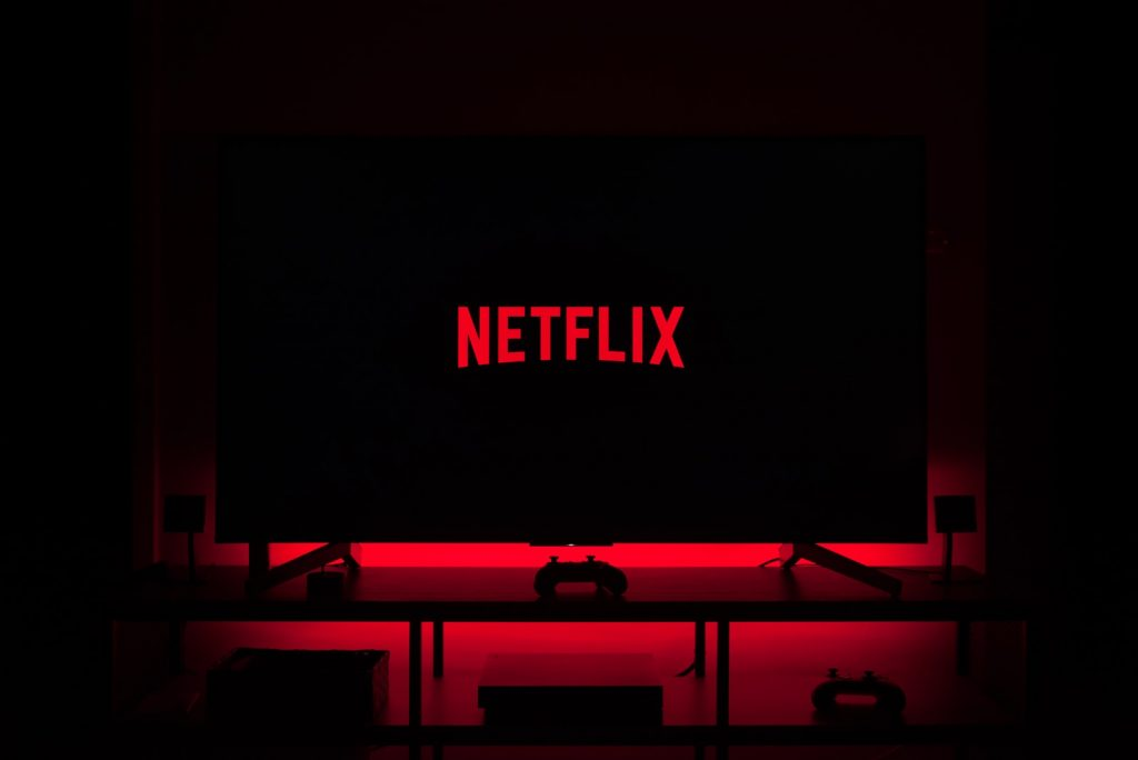 flat screen television displaying Netflix logo