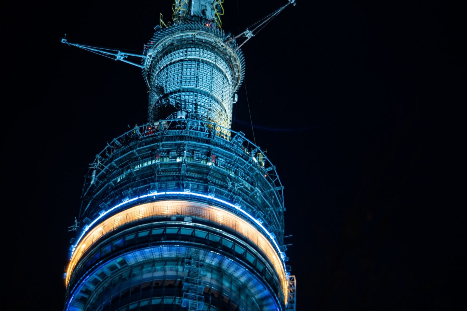 blue and black tower during night time
