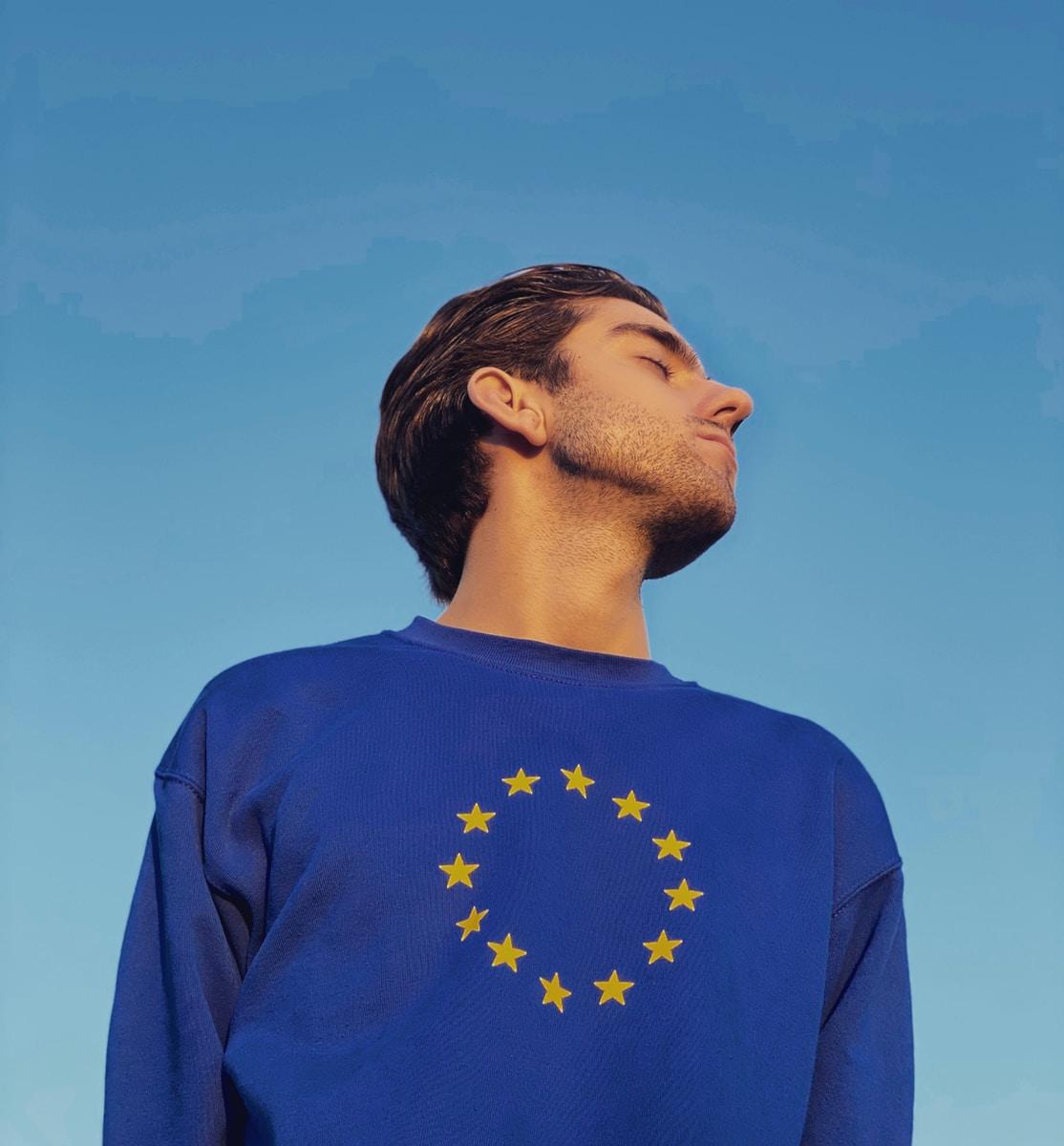 man in blue crew neck shirt under blue sky during daytime